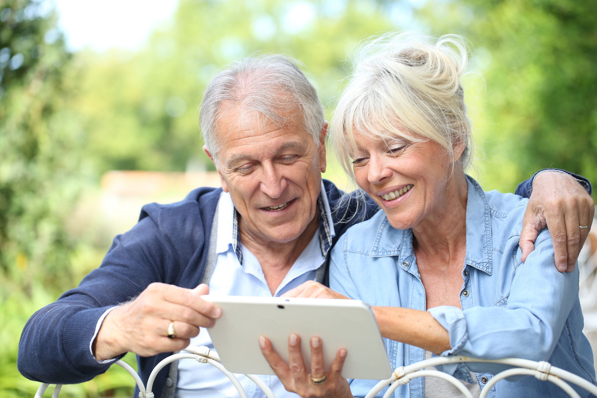 31750952 - senior couple connected on digital tablet