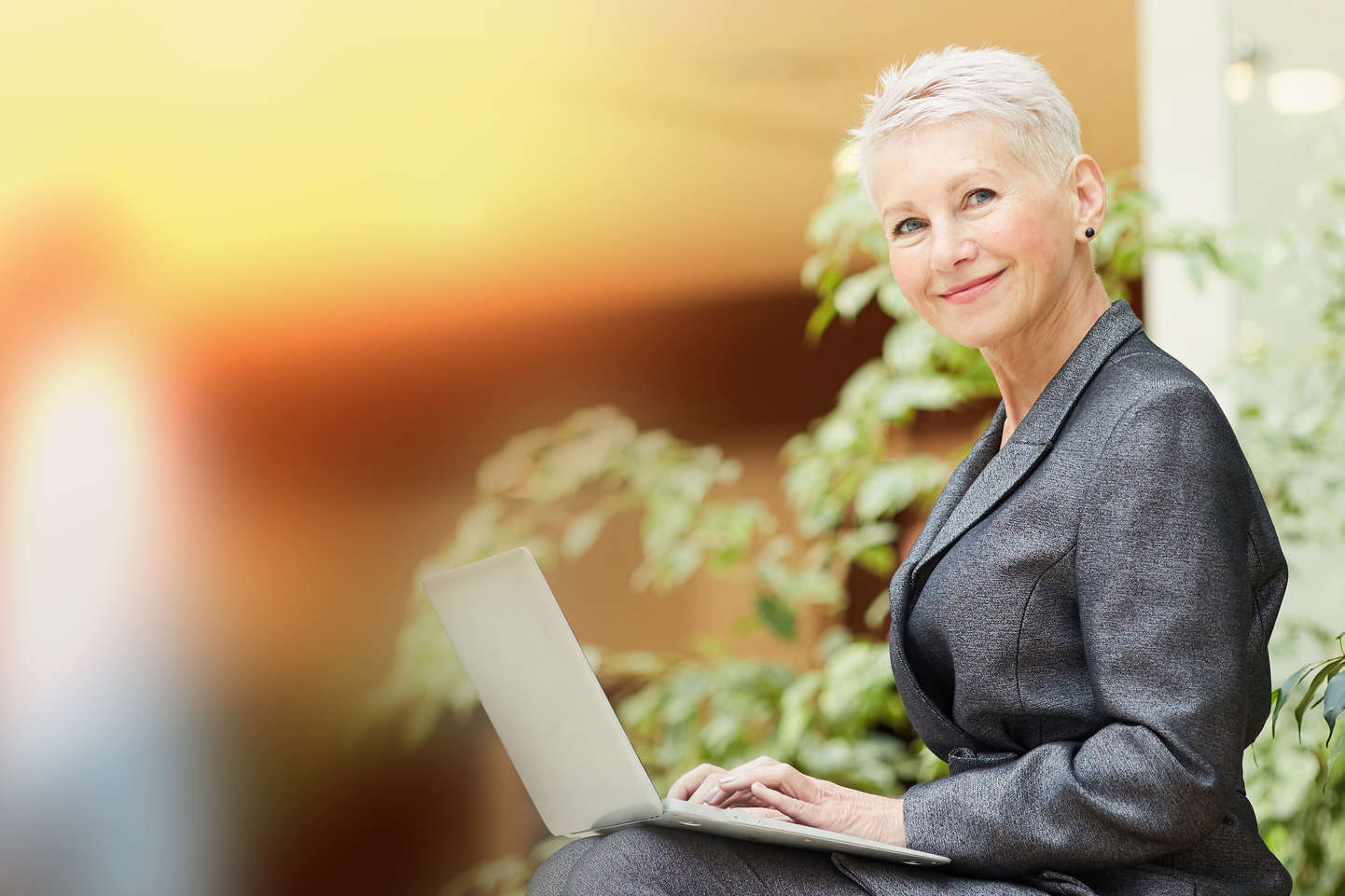 Successful Senior Businesswoman using Laptop
